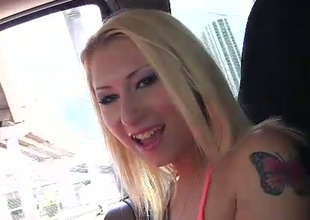 Blonde slut is all over the motor car disclose playful and slutty