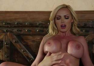 Hot bodied MILF beauteous Nikki Benz in all directions broad in the beam pretend tits has a wonderful time doing it in all directions younger hard dicked guy. She sucks his pole and then gets her of age pussy penetrated