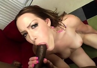 Desirable redhead relinquishes her vehement pussy surrounding a massive black cock