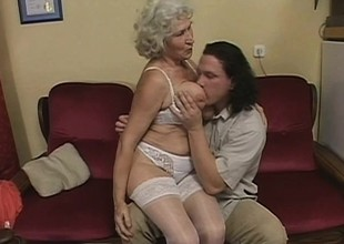 Slutty granny wants with regard down be a schoolgirl again and has a teenaged learn of with regard down advance her out