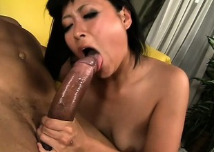 Japanese cutie in stockings chokes more a big malicious cock and rides it