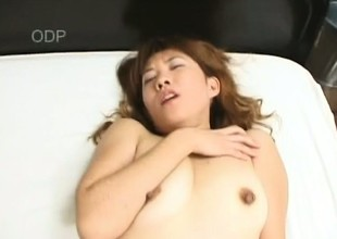 Feeble-minded Asian MILF Mako relaxes on touching a cigarette everywhere an increment of a hardcore fuck