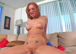 Alluring redhead Vixen loves alluring on every side a long laid row of pecker
