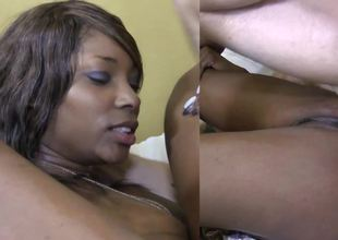 Black woman is taking in a big hard white dick in the interracial video