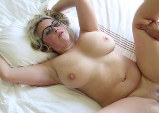 A blonde with glasses is getting a big pecker in her wet cunt