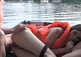 Hardcore above a boat with a cutie in a life vest